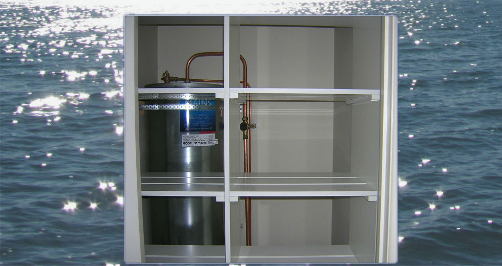 Custom white shelves in hot water cupboard for drying and storage