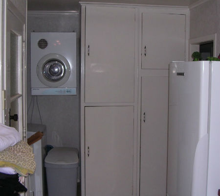 """""""Before"""" photo of laundry storage at a home in Thames New Zealand"""
