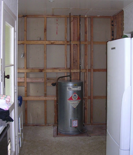 Laundry storage solution under construction at a home in Thames
