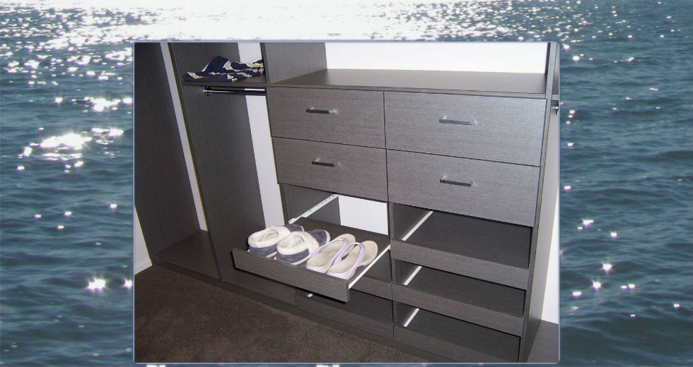 Pull-out shoe shelves in a wardrobe