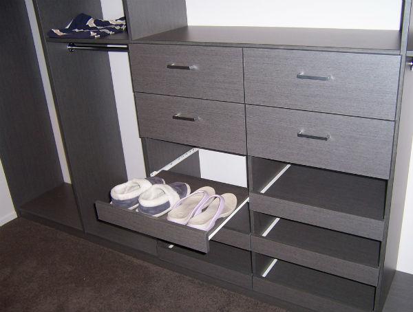 Sliding pull-out shoe shelves in a custom wardrobe. Built in the Coromandel.